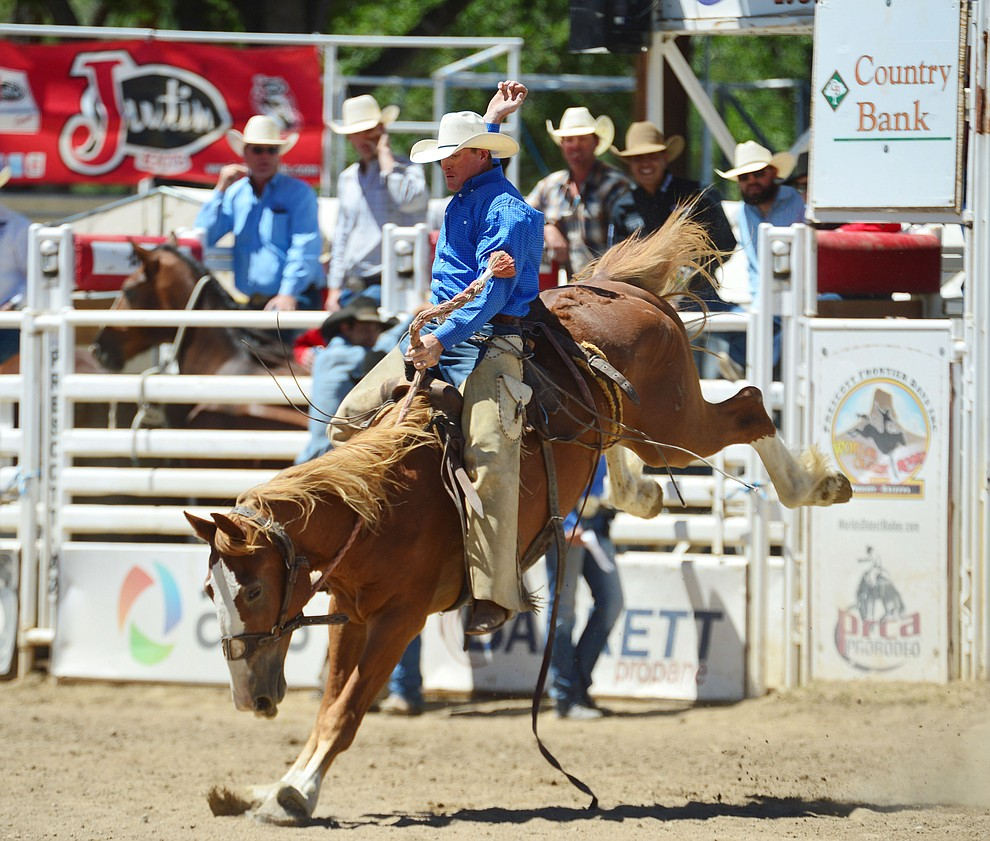 Miles Dewitt in the Cowpunchers Bronc Riding during the fourth performance of the Prescott Frontier Days Rodeo Thursday July 4, 2019.  (Les Stukenberg/Courier)