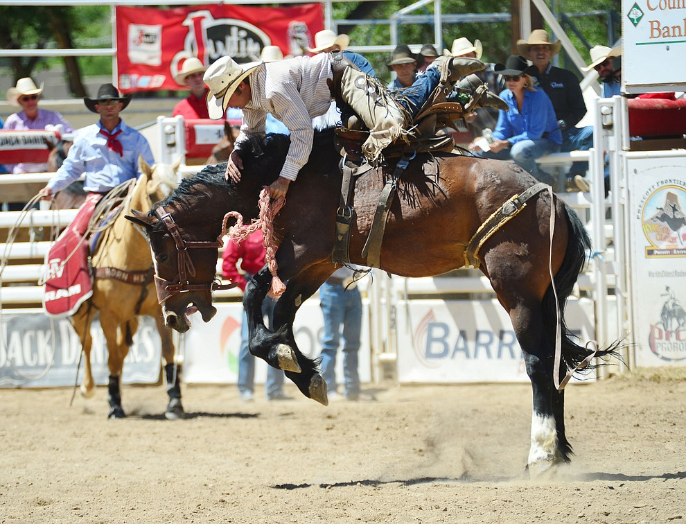 Alex Burnham in the Cowpunchers Bronc Riding during the fourth performance of the Prescott Frontier Days Rodeo Thursday July 4, 2019.  (Les Stukenberg/Courier)