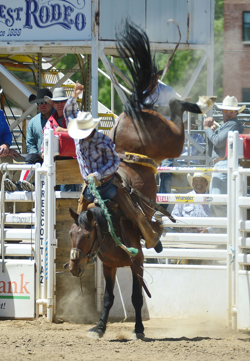 Huckleberry Sandsness in the Cowpunchers Bronc Riding during the fourth performance of the Prescott Frontier Days Rodeo Thursday July 4, 2019.  (Les Stukenberg/Courier)