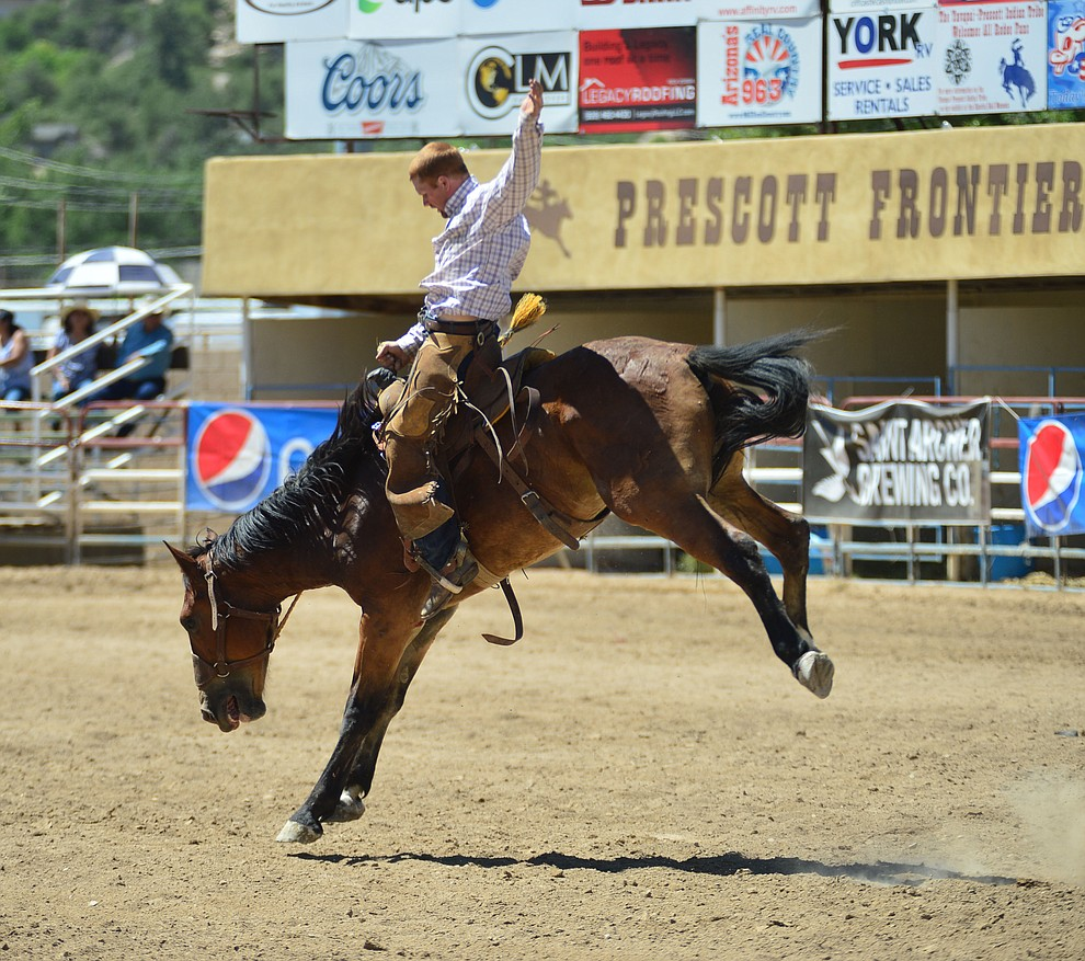 Timber Holmquist in the Cowpunchers Bronc Riding during the fourth performance of the Prescott Frontier Days Rodeo Thursday July 4, 2019.  (Les Stukenberg/Courier)