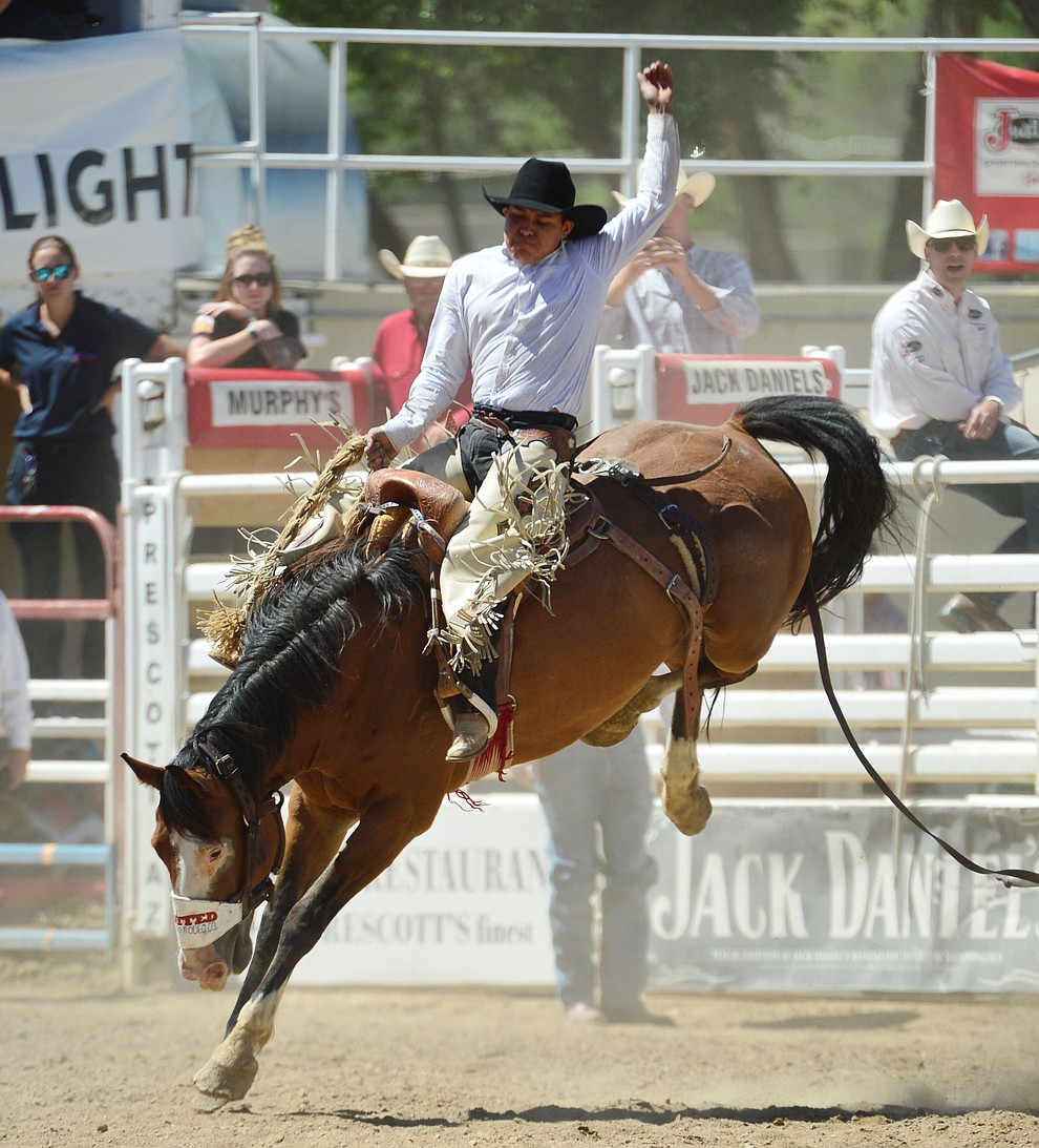 Creighton Curley on Richocette in the saddle bronc riding during the fourth performance of the Prescott Frontier Days Rodeo Thursday July 4, 2019.  (Les Stukenberg/Courier)