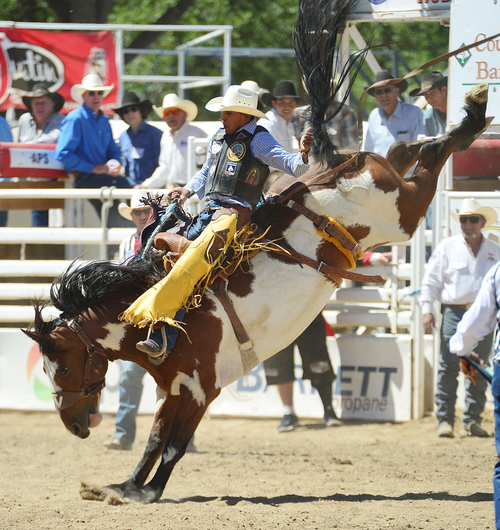 Jay Joaquin on Painted Bear scored 80 in the saddle bronc riding during the fourth performance of the Prescott Frontier Days Rodeo Thursday July 4, 2019.  (Les Stukenberg/Courier)