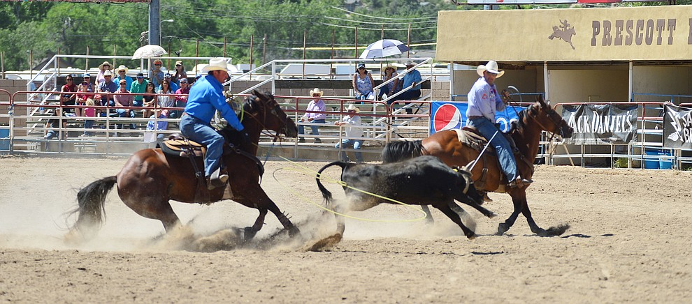 Rich Skelton and David Key in the team roping during the fourth performance of the Prescott Frontier Days Rodeo Thursday July 4, 2019.  (Les Stukenberg/Courier)