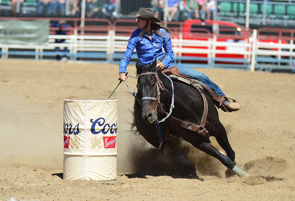 Breezy Brock in the barrel racing during the fourth performance of the Prescott Frontier Days Rodeo Thursday July 4, 2019.  (Les Stukenberg/Courier)