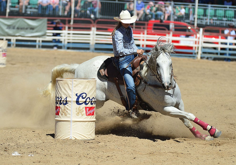 Halle Dewitt in the barrel racing during the fourth performance of the Prescott Frontier Days Rodeo Thursday July 4, 2019.  (Les Stukenberg/Courier)