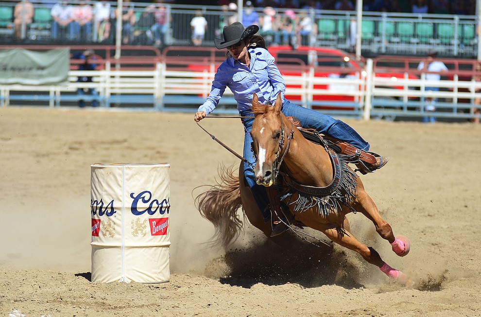 Kelly Robertson in the barrel racing during the fourth performance of the Prescott Frontier Days Rodeo Thursday July 4, 2019.  (Les Stukenberg/Courier)