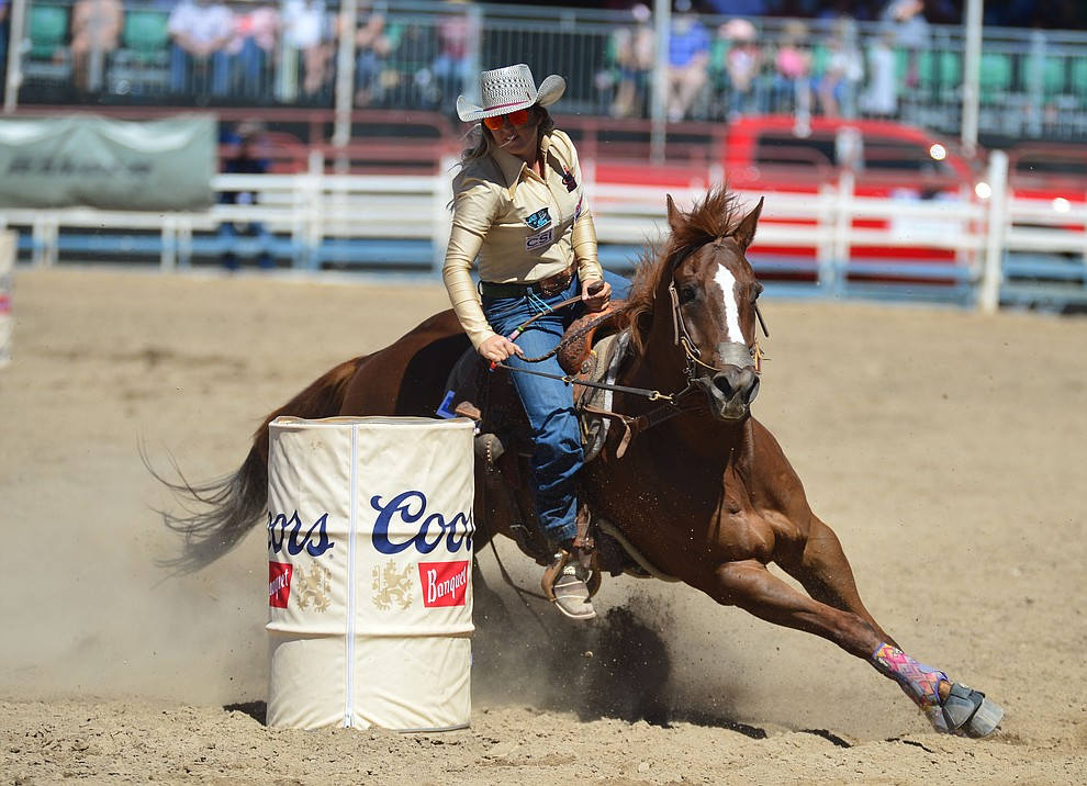 Cheyenne Lindsey in the barrel racing during the fourth performance of the Prescott Frontier Days Rodeo Thursday July 4, 2019.  (Les Stukenberg/Courier)