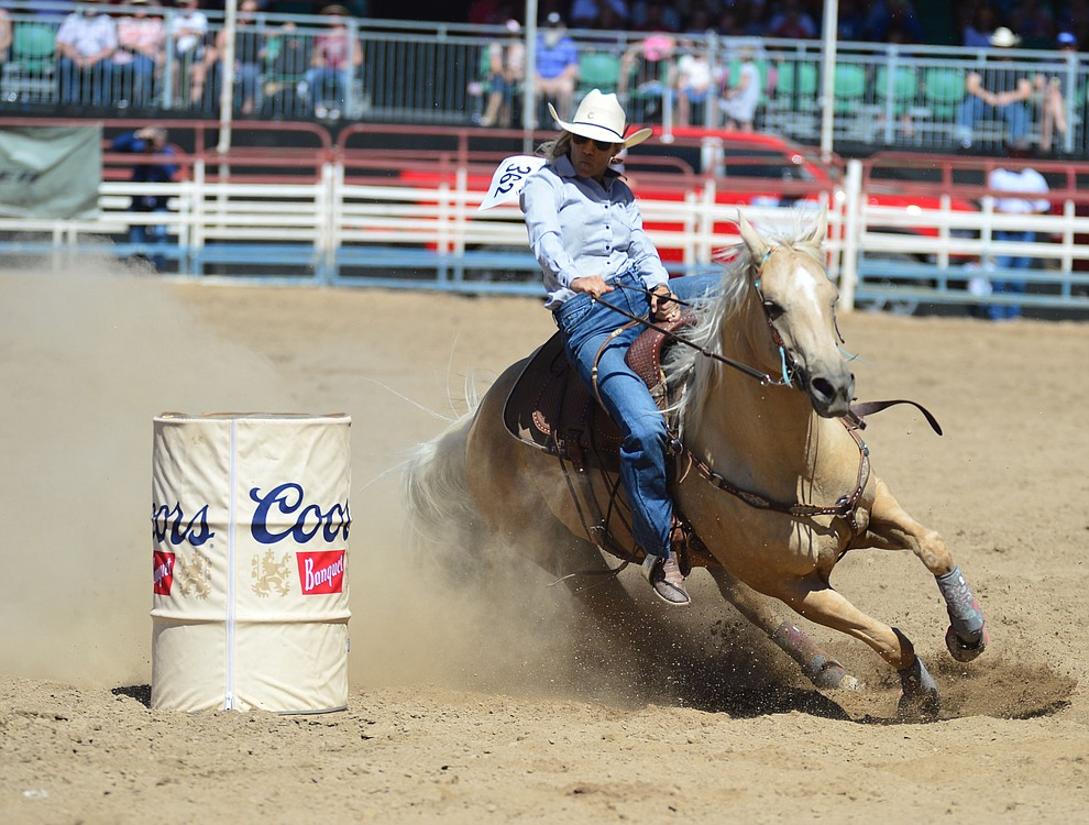 Julie Miller in the barrel racing during the fourth performance of the Prescott Frontier Days Rodeo Thursday July 4, 2019.  (Les Stukenberg/Courier)