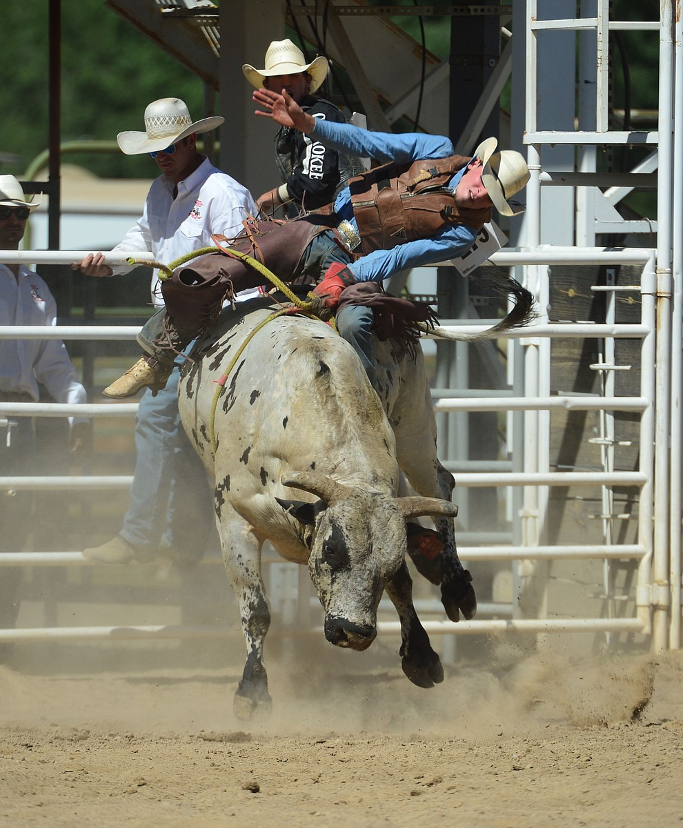 Daniel Keeping scores 86.5 on Last Cigarette in the bull riding during the fourth performance of the Prescott Frontier Days Rodeo Thursday July 4, 2019.  (Les Stukenberg/Courier)