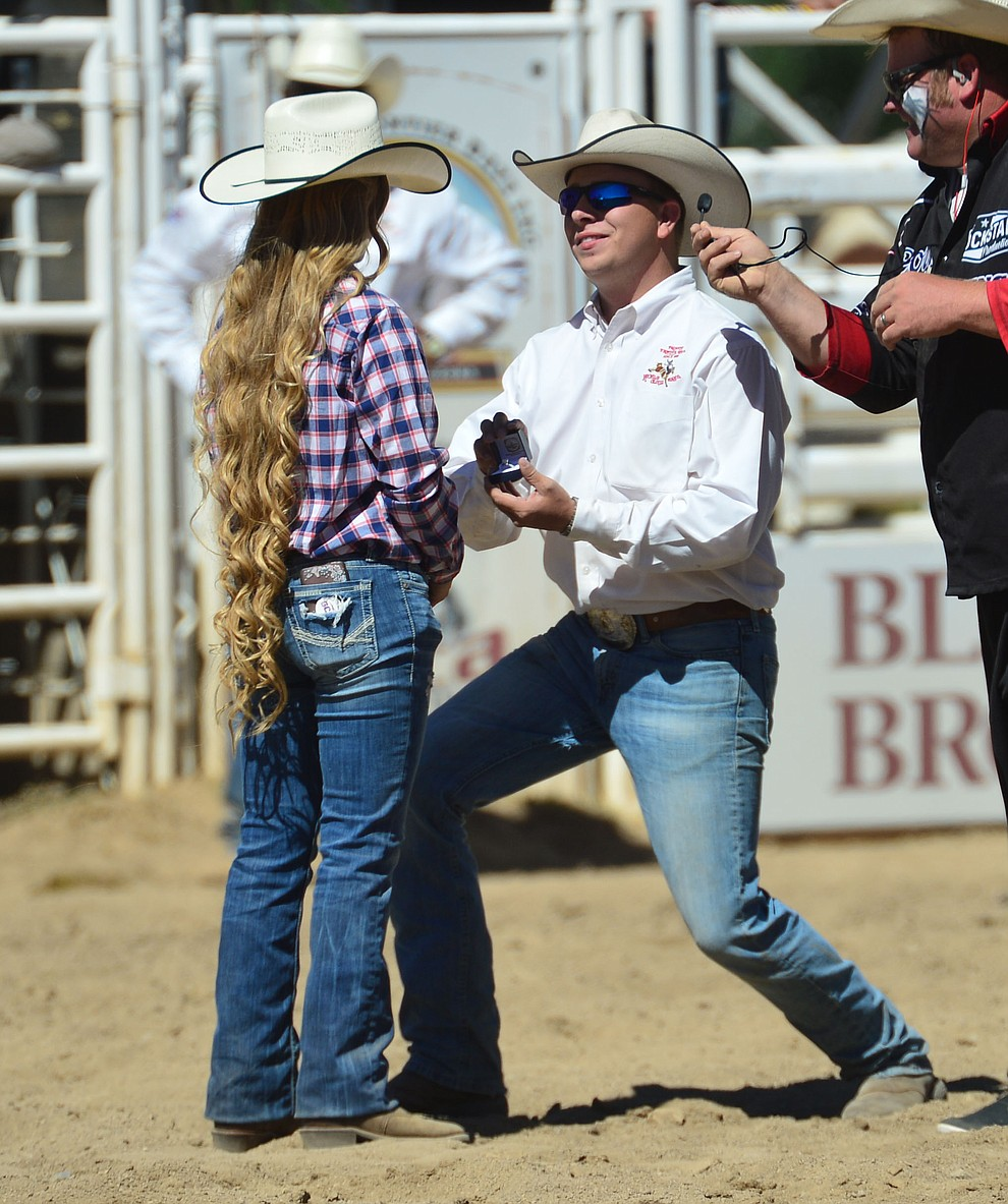 Chase Peters asks Sara Satathite to marry him during the fourth performance of the Prescott Frontier Days Rodeo Thursday July 4, 2019. She said yes! (Les Stukenberg/Courier)