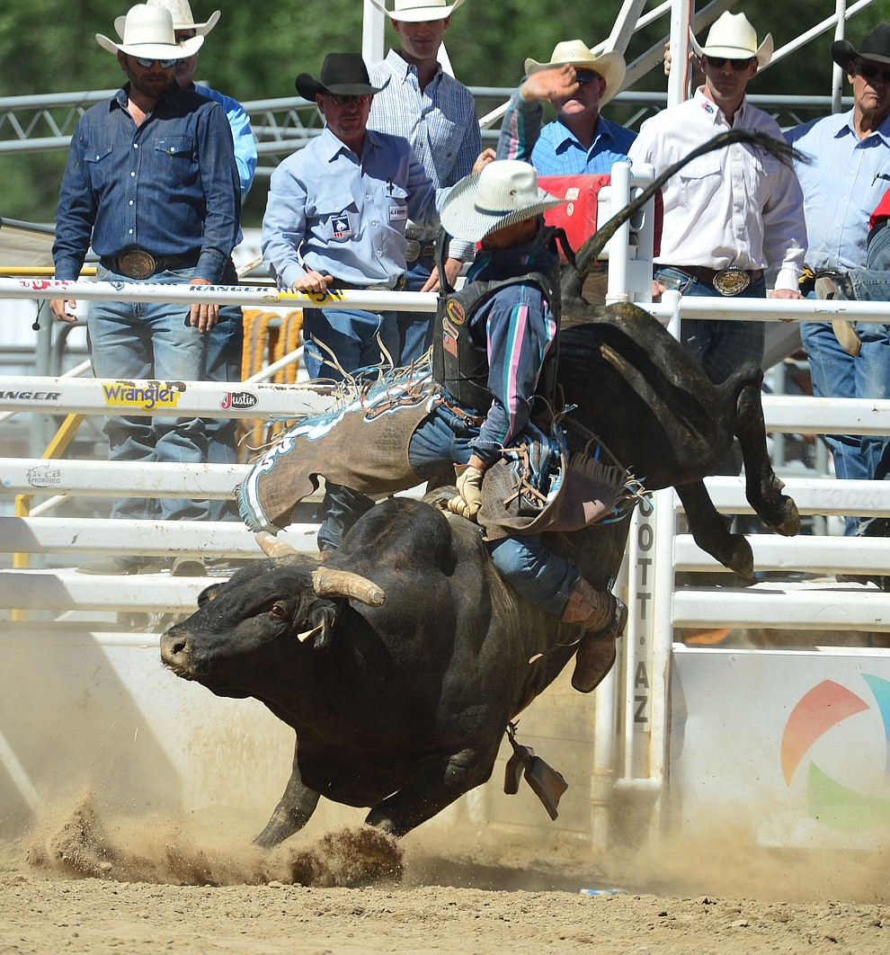 John Mast on House of Pain in the bull riding during the fourth performance of the Prescott Frontier Days Rodeo Thursday July 4, 2019.  (Les Stukenberg/Courier)