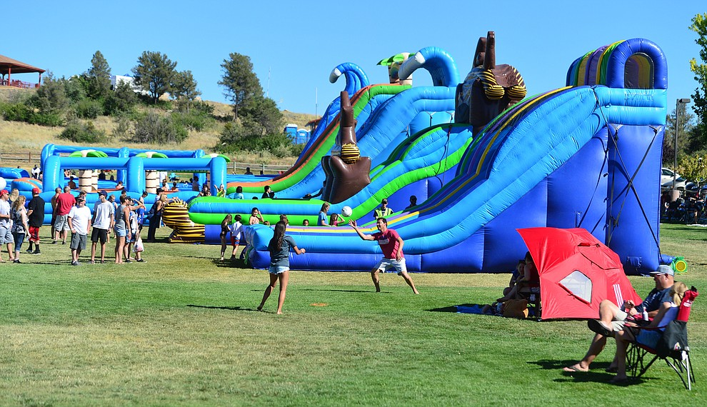 Large water slides lined the grassy area at the City of Prescott's Watson Lake Fourth of July Celebration Thursday July 4, 2019.  (Les Stukenberg/Courier)