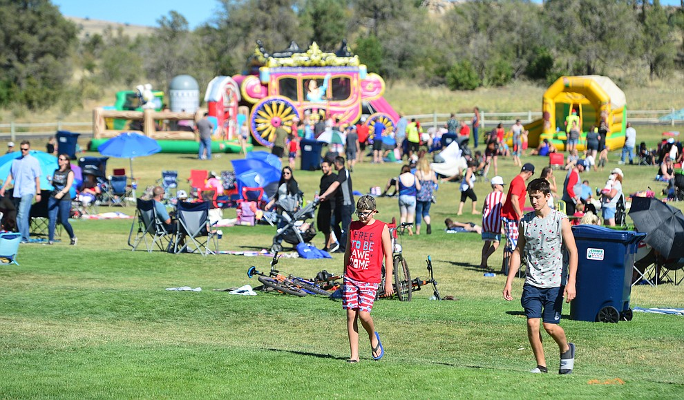 Families enjoy the grass, water slides and food at the City of Prescott's Watson Lake Fourth of July Celebration Thursday July 4, 2019.  (Les Stukenberg/Courier)