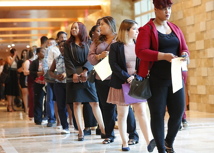 In this Tuesday, June 4, 2019 photo, job applicants line up at the Seminole Hard Rock Hotel & Casino Hollywood during a job fair in Hollywood, Fla. On Friday, July 5, the U.S. government issues the June jobs report. (Wilfredo Lee/AP)