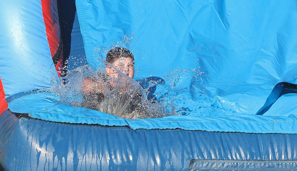 Edward Hunter (7 yrs old) of Chino Valley enjoys the splash down slide at the Chino Valley July 4th Celebration.