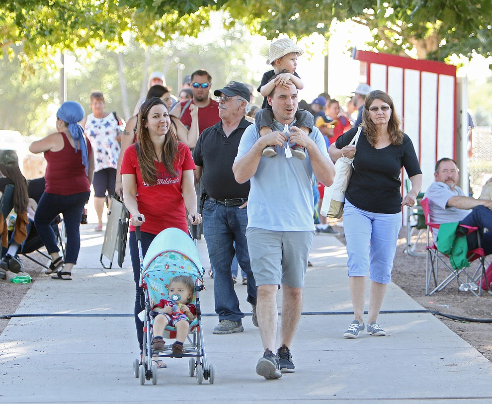 The Tyson Family, Derek (stroller), mom Tessa, dad Mark, and Nathan (on shoulders)  visited from Phoenix to enjoy the Chino Valley July 4th Celebration.