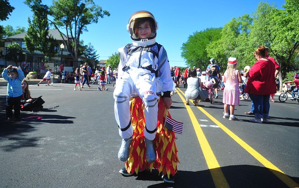McKenzie Oudin is an astronaut blasting off for the 78th annual Kiwanis Kiddie Parade along Cortez Street in downtown Prescott Friday July 5, 2019.  (Les Stukenberg/Courier)