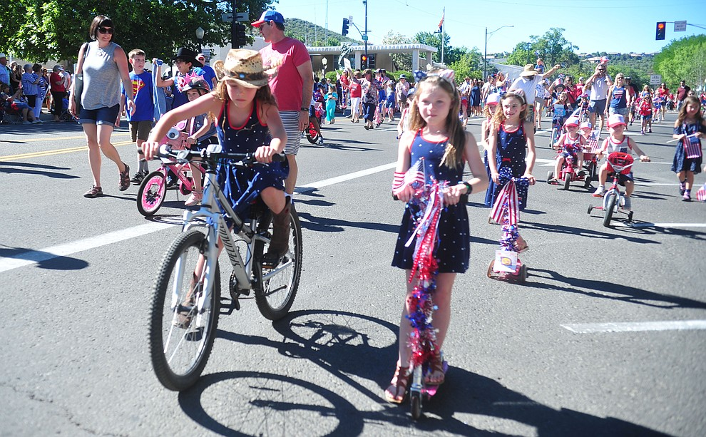 Children on bikes and scooters ride during the 78th annual Kiwanis Kiddie Parade along Cortez Street in downtown Prescott Friday July 5, 2019.  (Les Stukenberg/Courier)
