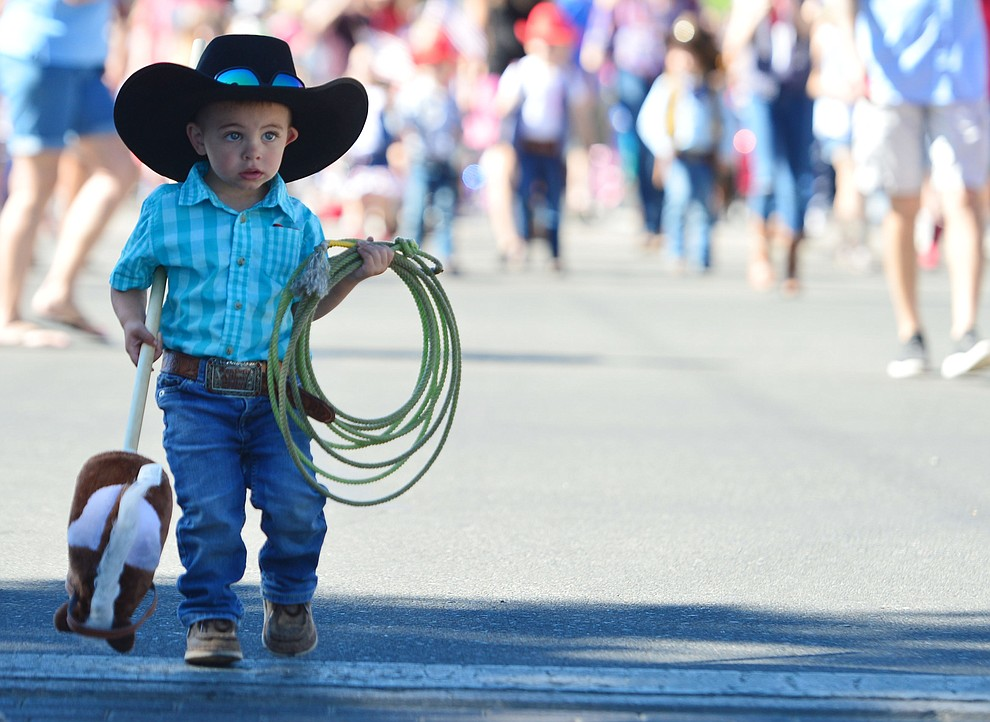 A little roper during the 78th annual Kiwanis Kiddie Parade along Cortez Street in downtown Prescott Friday July 5, 2019.  (Les Stukenberg/Courier)