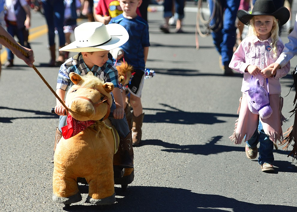 Riding down the street during the 78th annual Kiwanis Kiddie Parade along Cortez Street in downtown Prescott Friday July 5, 2019.  (Les Stukenberg/Courier)