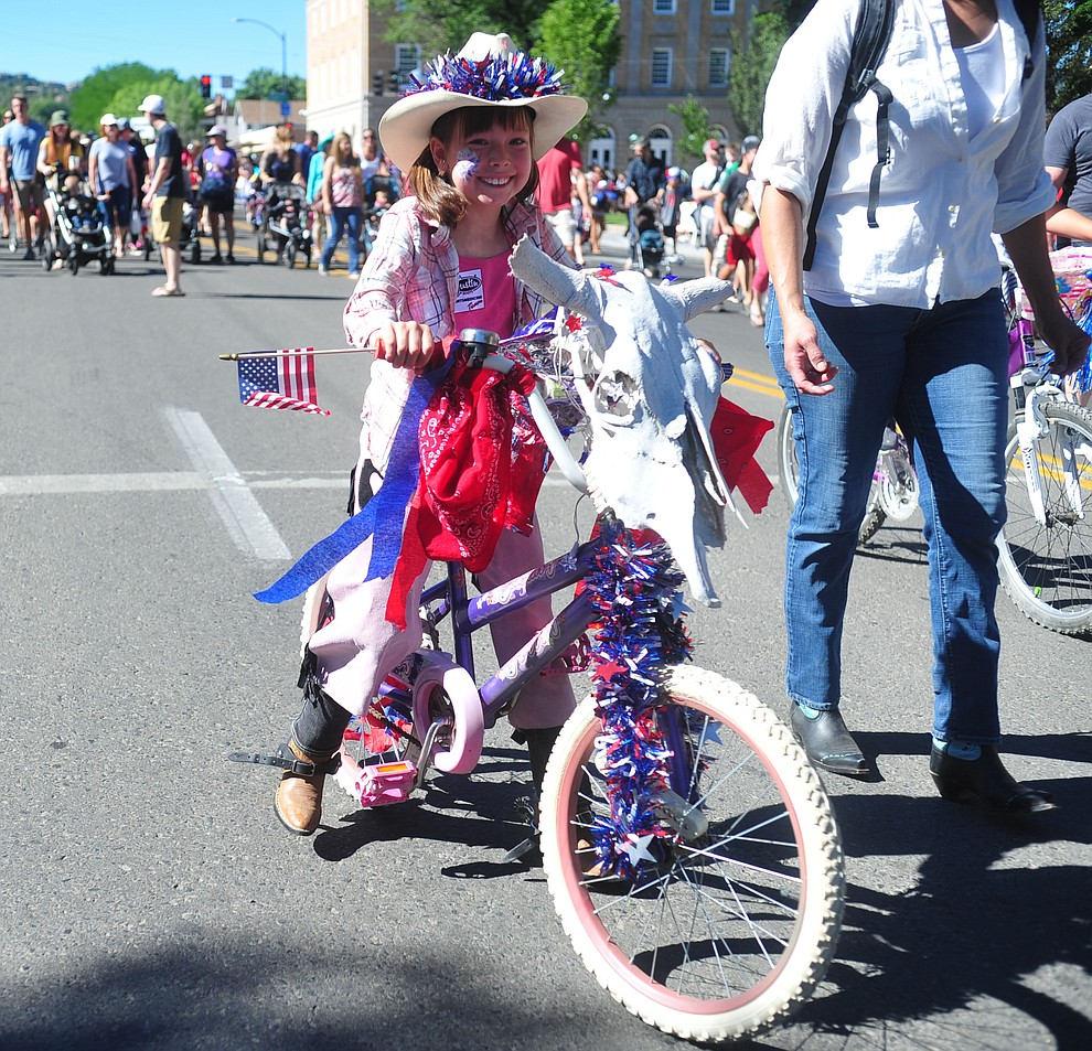 Ella Pifer rides her bike during the 78th annual Kiwanis Kiddie Parade along Cortez Street in downtown Prescott Friday July 5, 2019.  (Les Stukenberg/Courier)