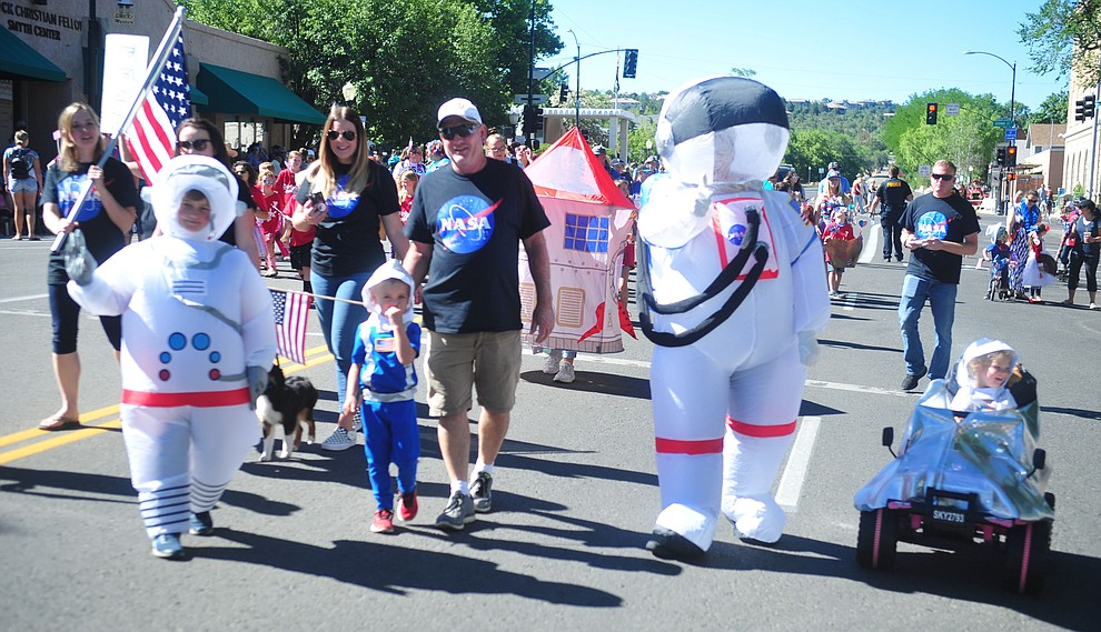 The Barney family celebrates the lunar landing during the 78th annual Kiwanis Kiddie Parade along Cortez Street in downtown Prescott Friday July 5, 2019.  (Les Stukenberg/Courier)