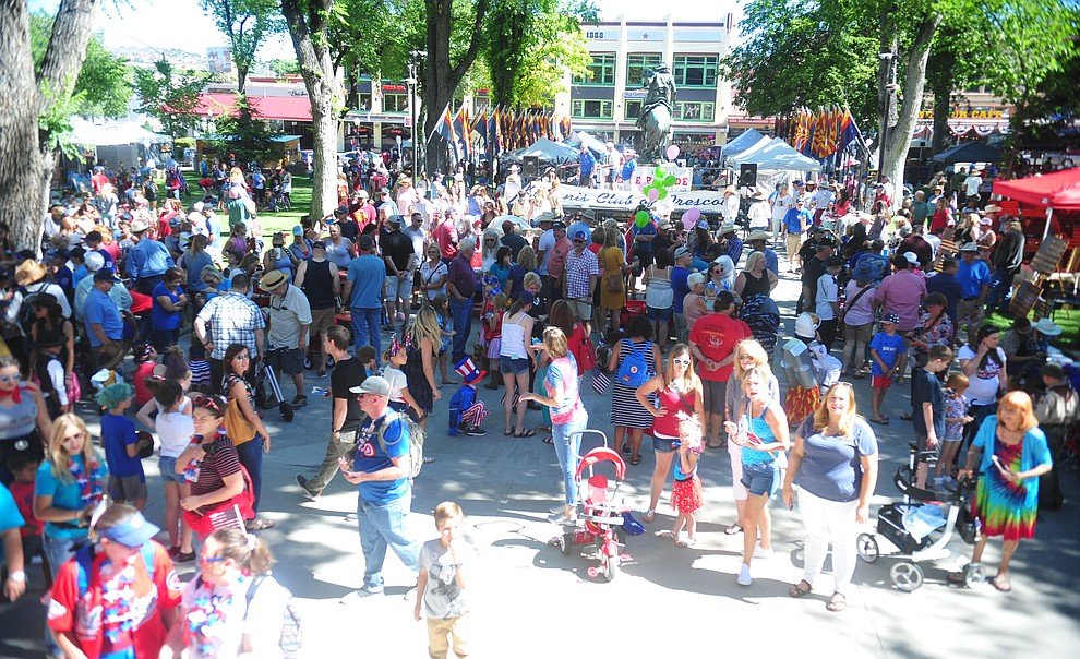 A large crowd gathers on the Courthouse Plaza following the 78th annual Kiwanis Kiddie Parade along Cortez Street in downtown Prescott Friday July 5, 2019.  (Les Stukenberg/Courier)