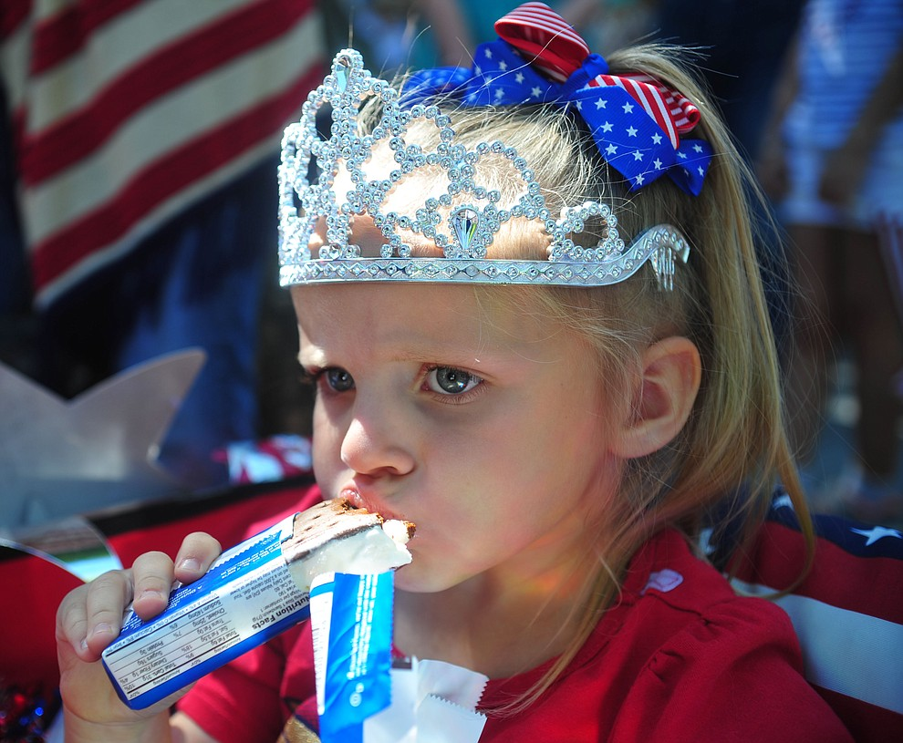 Tymbi Tompkins enjoys her ice cream sandwich following the 78th annual Kiwanis Kiddie Parade along Cortez Street in downtown Prescott Friday July 5, 2019.  (Les Stukenberg/Courier)