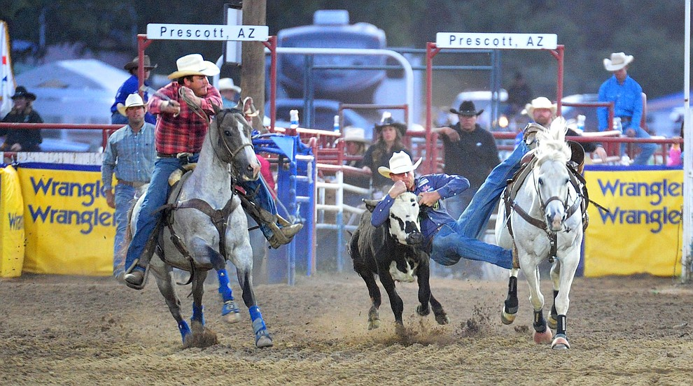 Blake Mindemann has a 4.6 second run in the steer wrestling during the 5th performance of the Prescott Frontier Days Rodeo at the Prescott Rodeo grounds Friday July 5, 2019.  (Les Stukenberg/Courier)