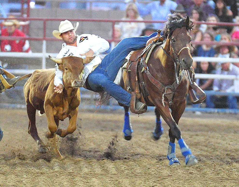 Tyler Waguespack drops in during the steer wrestling at the the 5th performance of the Prescott Frontier Days Rodeo Prescott Friday July 5, 2019.  (Les Stukenberg/Courier)