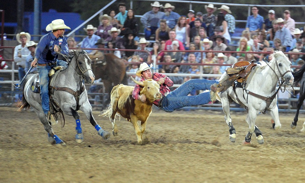 Jacob Edler has a 6.3 second run in the steer wrestling during the 5th performance of the Prescott Frontier Days Rodeo at the Prescott Rodeo grounds Friday July 5, 2019.  (Les Stukenberg/Courier)