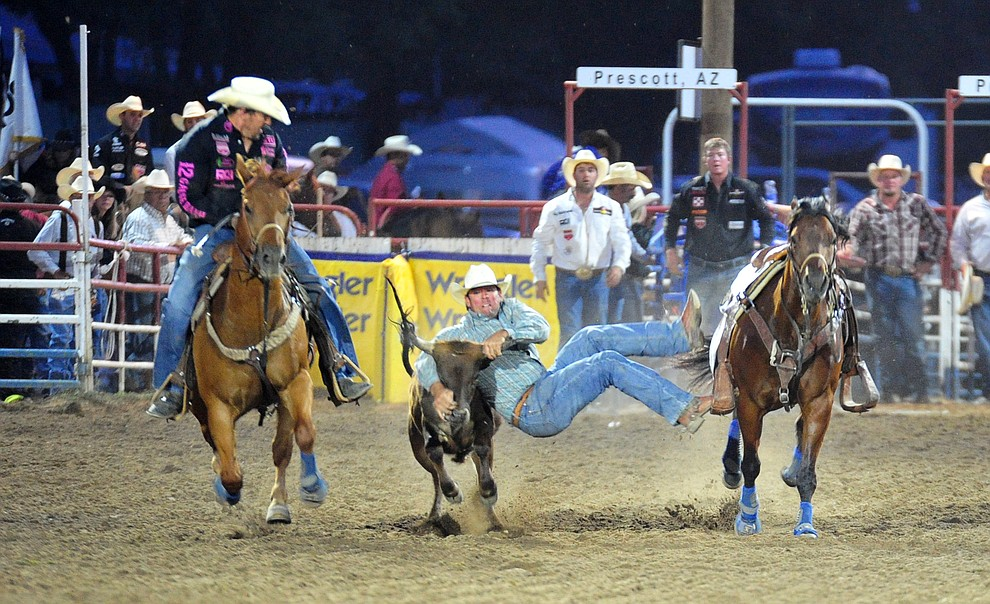 TJ Hall has a 4.9 second run in the steer wrestling during the 5th performance of the Prescott Frontier Days Rodeo at the Prescott Rodeo grounds Friday July 5, 2019.  (Les Stukenberg/Courier)
