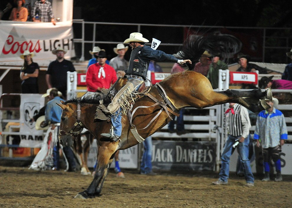 D.J. Stoneburner scores 77 on Dakota Babe in the saddle bronc during the 5th performance of the Prescott Frontier Days Rodeo at the Prescott Rodeo grounds Friday July 5, 2019.  (Les Stukenberg/Courier)