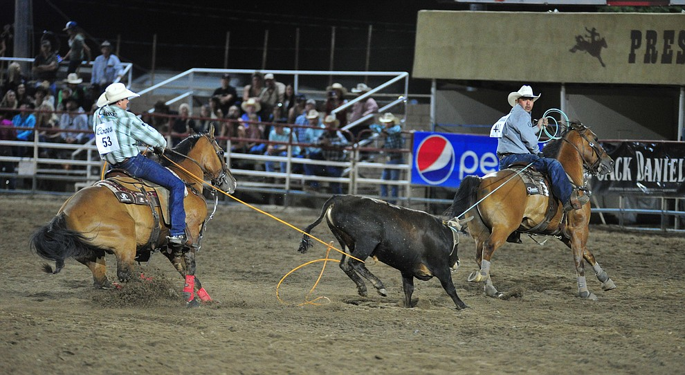 Paden Bray and Erich Rogers have a 7.2 second run in the team roping during the 5th performance of the Prescott Frontier Days Rodeo at the Prescott Rodeo grounds Friday July 5, 2019.  (Les Stukenberg/Courier)