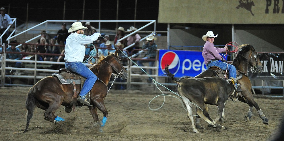Kolton Schmidt and Jeremy Buhler have a 6.9 second run in the team roping during the 5th performance of the Prescott Frontier Days Rodeo at the Prescott Rodeo grounds Friday July 5, 2019.  (Les Stukenberg/Courier)