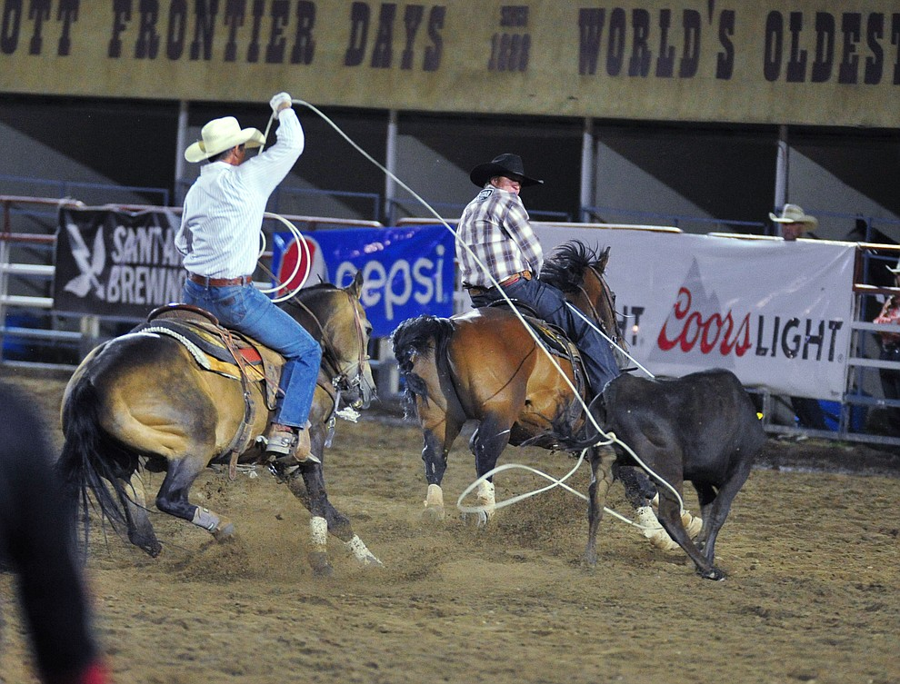 Trey Blackmore and Seth Hall have a 7.6 second run in the team roping during the 5th performance of the Prescott Frontier Days Rodeo at the Prescott Rodeo grounds Friday July 5, 2019.  (Les Stukenberg/Courier)