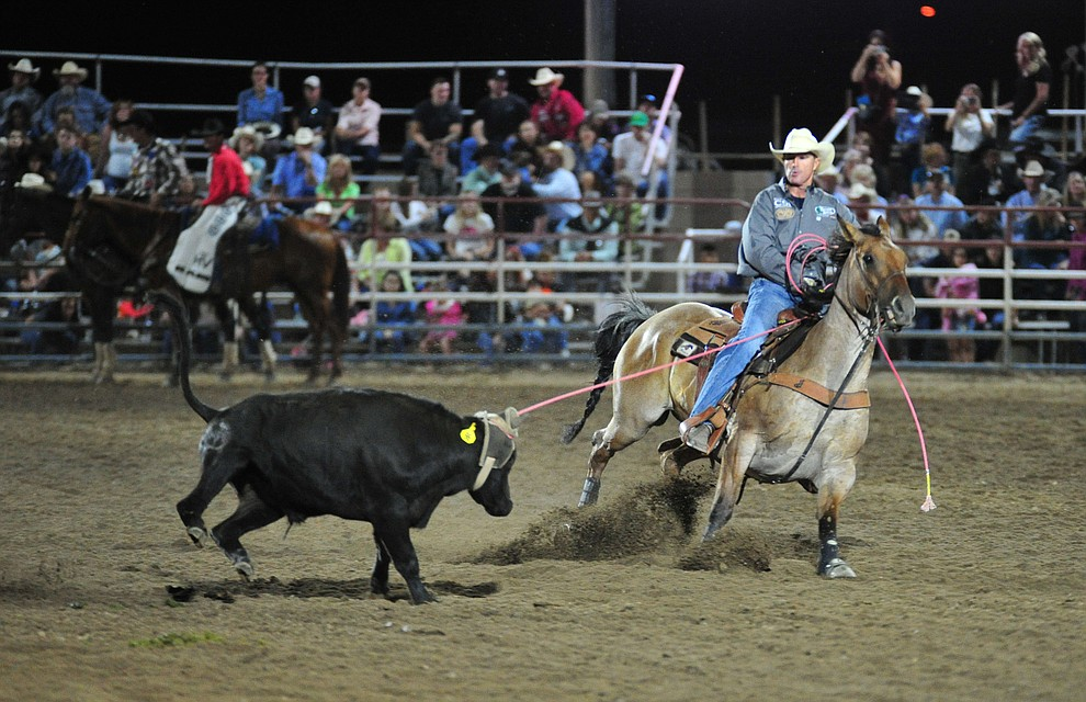 Matt Sherwood and his partner Hunter Koch, not pictured, have a 7.3 second run in the team roping during the 5th performance of the Prescott Frontier Days Rodeo at the Prescott Rodeo grounds Friday July 5, 2019.  (Les Stukenberg/Courier)