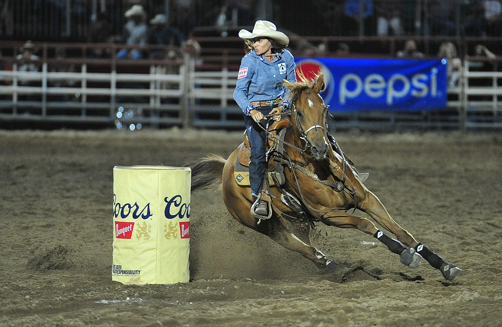 Sarah Kieckhefer runs a fast 17.70 run in the barrel race during the 5th performance of the Prescott Frontier Days Rodeo Prescott Friday July 5, 2019.  (Les Stukenberg/Courier)