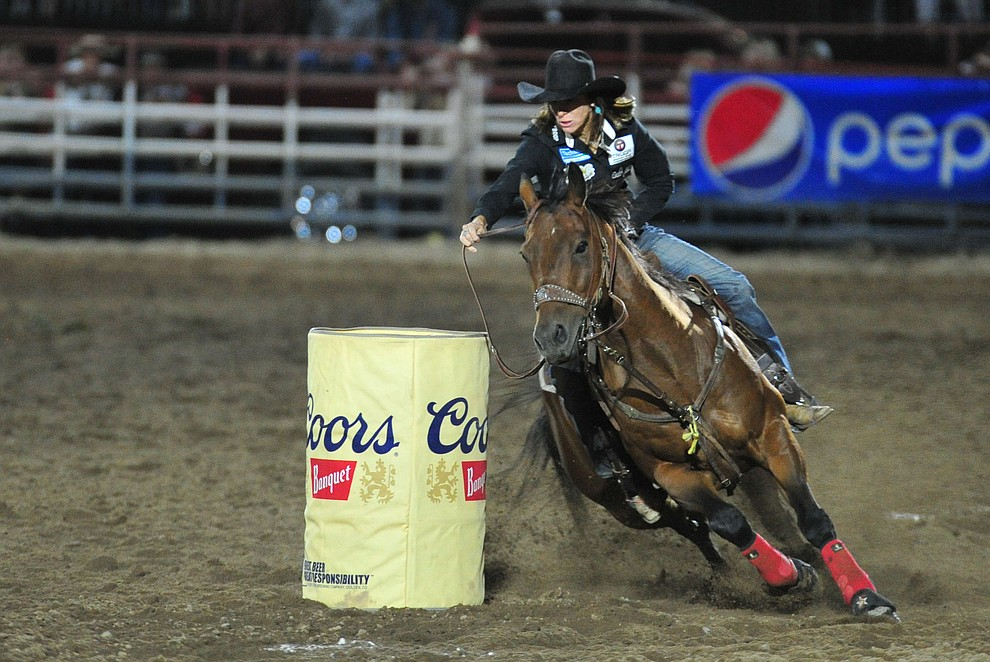 Lori Todd takes the lead in the barrel race with this 17.45 second run during the 5th performance of the Prescott Frontier Days Rodeo at the Prescott Rodeo grounds Friday July 5, 2019.  (Les Stukenberg/Courier)