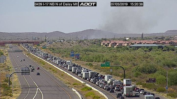 An Arizona Department of Transportation (ADOT) camera along Interstate 17 at Daisy Mountain Drive in the Anthem area shows the backup of traffic Wednesday afternoon, July 3, due to a brush fire north of Phoenix. Construction of new lanes — expected to start in 2021 — is intended to help alleviate clogged traffic on the interstate. (ADOT/Courtesy)