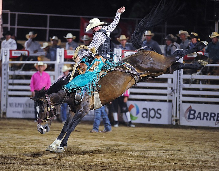 Taos Muncy scored 87 on High Loonesome in saddle bronc riding during the second performance of the Prescott Frontier Days Rodeo on Tuesday, July 2, 2019. (Les Stukenberg/Courier)