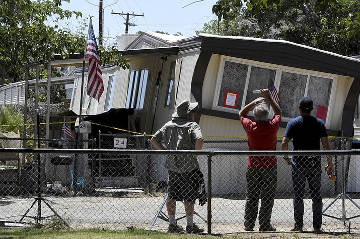 People observe a mobile home in Ridgecrest, Calif. on Friday July 5, 2019. The home was knocked off its foundation in the Fourth of July earthquake. (James Quigg/The Daily Press via AP)