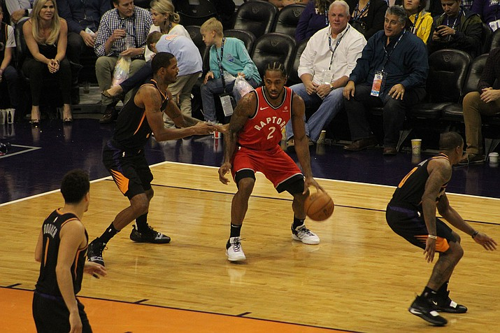 Kawhi Leonard (2) takes on the Phoenix Suns in this Jan. 17, 2019 photo. AP reports that Leonard will sign with the Los Angeles Clippers, which also traded with Oklahoma City for Paul George. (Photo by Beau Bearden/Daily Miner)