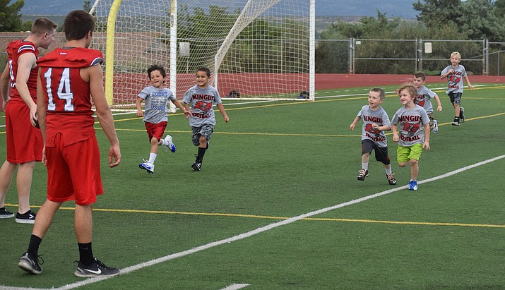 Campers run to their next station at last year's Mingus Marauders Youth Football Camp. VVN/James Kelley