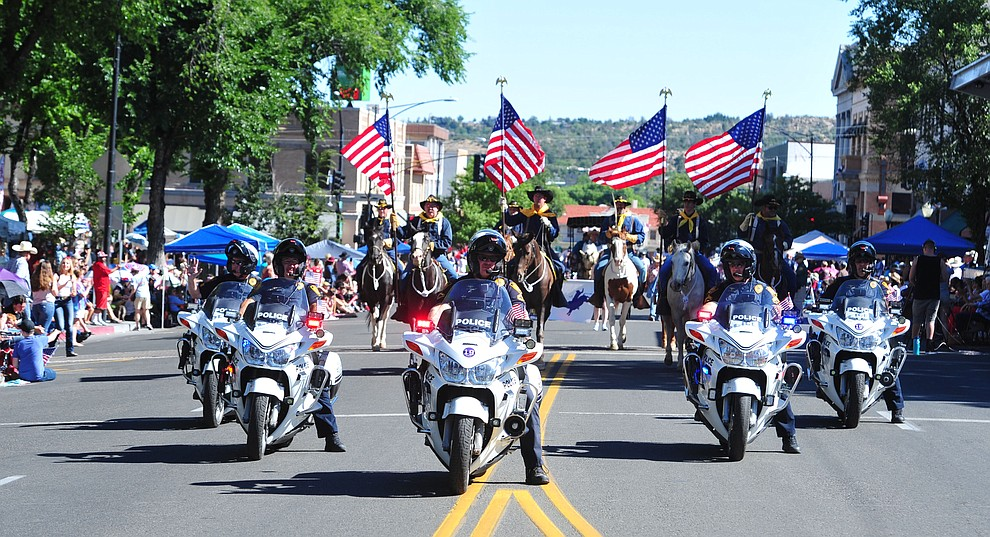 A Prescott Police motorcycle escort opens the Prescott Frontier Days Rodeo Parade through the streets of downtown Prescott Saturday July 6, 2019.  (Les Stukenberg/Courier)