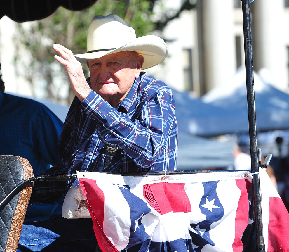 Clyde Allred the Grand Marshal of the Prescott Frontier Days Rodeo Parade through the streets of downtown Prescott Saturday July 6, 2019.  (Les Stukenberg/Courier)