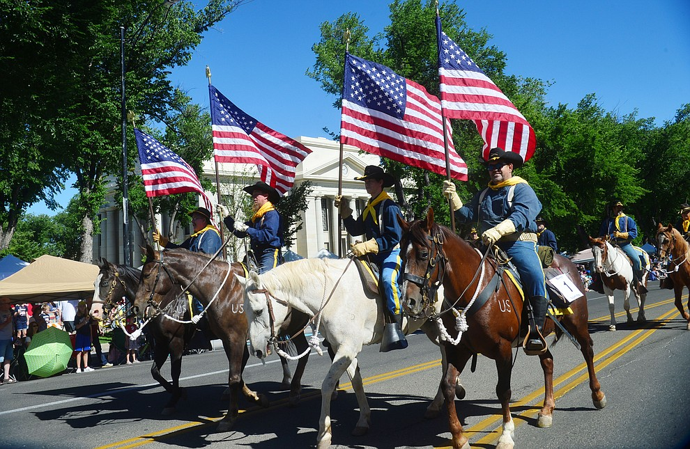 The Camp Verde Calvary during the Prescott Frontier Days Rodeo Parade through the streets of downtown Prescott Saturday July 6, 2019.  (Les Stukenberg/Courier)