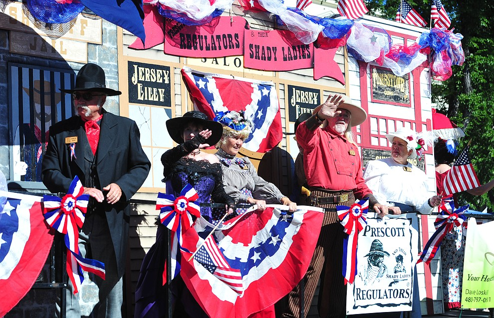Prescott Regulators and their Shady Ladies during the Prescott Frontier Days Rodeo Parade through the streets of downtown Prescott Saturday July 6, 2019.  (Les Stukenberg/Courier)