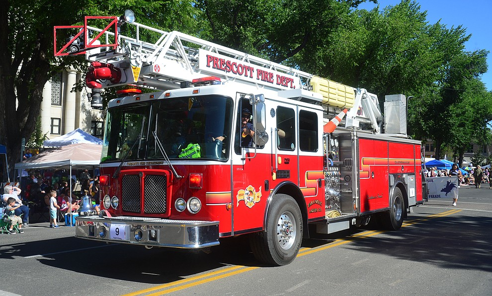Prescott Fire Department's ladder truck during the Prescott Frontier Days Rodeo Parade through the streets of downtown Prescott Saturday July 6, 2019.  (Les Stukenberg/Courier)