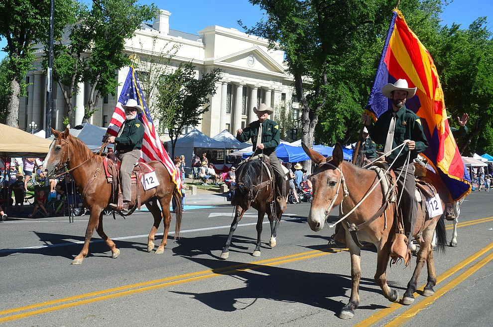 Yavapai County Sheriff's Office Mounted Posse during the Prescott Frontier Days Rodeo Parade through the streets of downtown Prescott Saturday July 6, 2019.  (Les Stukenberg/Courier)
